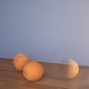 Two oranges and a reflection