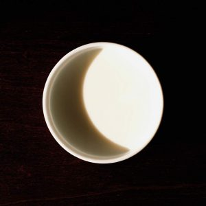 Shadow in a cup of milk