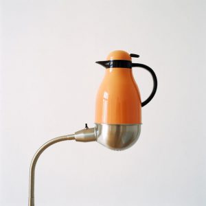 Thermos placed on lamp