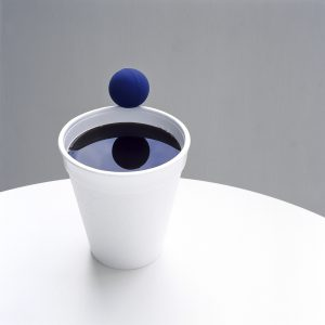 Bouncing ball on the edge of a styrofoam cup