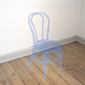 The shade of a chair painted onto wall, panel and floor