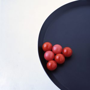 Two plastic balls and four tomatoes